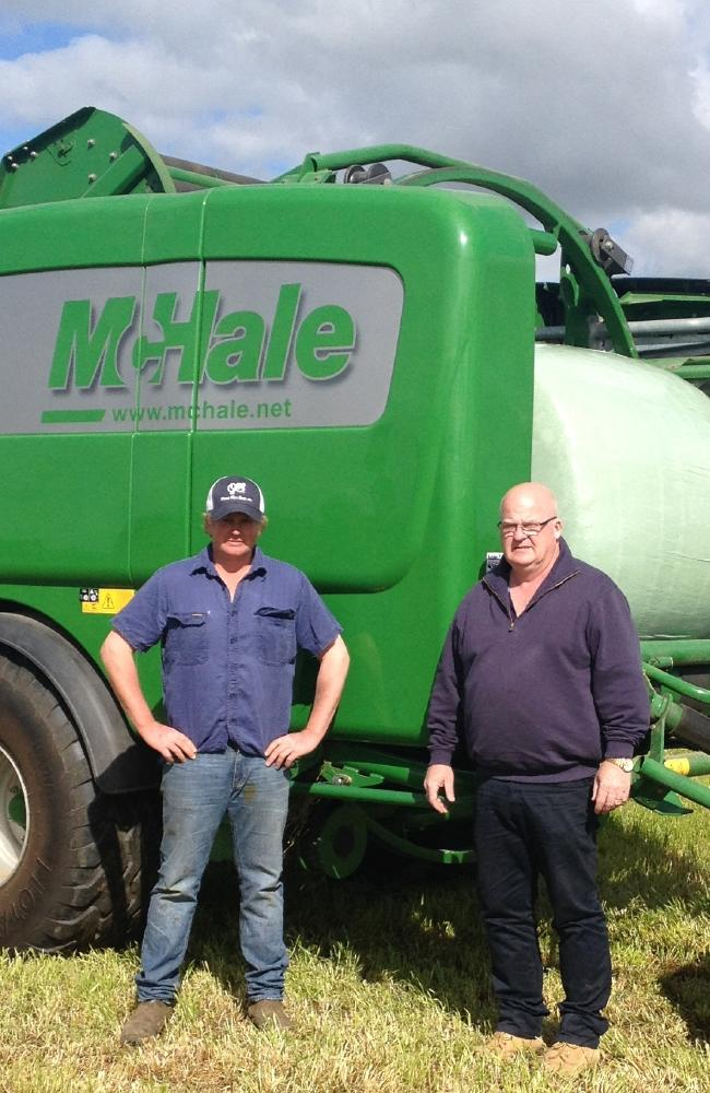 Darren Crawford, left, and Bertoli Farm Machinery's Paul Watt with the McHale Fusion 3 variable-chamber baler wrapper.
